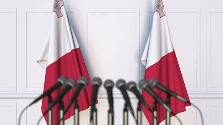 Maltese official press conference. Flags of Malta and microphones. Conceptual 3D rendering