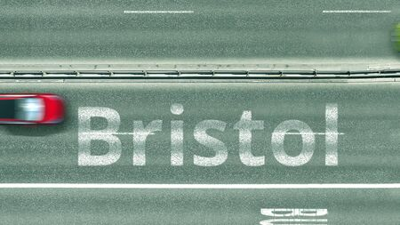 Top down view of the highway with revealing Bristol text. Driving to the United Kingdom 3D rendering