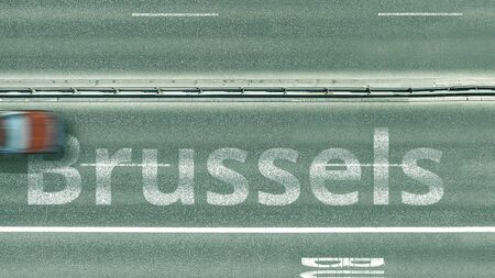 Aerial top down view of the road with cars revealing Brussels caption. Car travel in Belgium 3D rendering Imagens