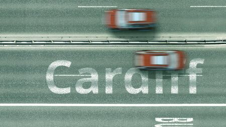 Top down view of the highway with revealing Cardiff text. Driving to the United Kingdom 3D rendering