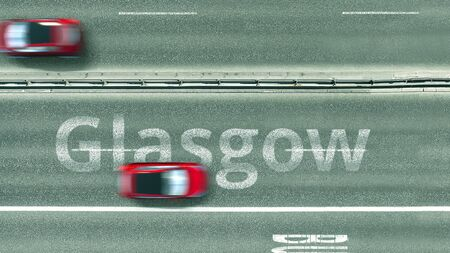 Aerial down view of the motorway with cars revealing Glasgow caption. Car travel to the United Kingdom 3D rendering