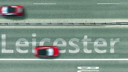 Aerial down view of the motorway with cars revealing Leicester caption. Car travel to the United Kingdom 3D rendering