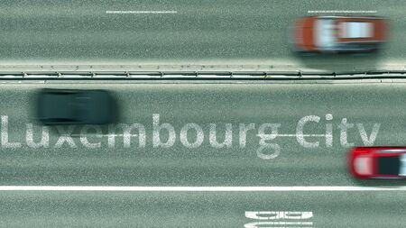 Top down view of the highway with revealing Luxembourg city text. Driving in Luxembourg 3D rendering