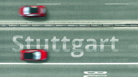 Aerial down view of the motorway with cars revealing Stuttgart caption. Car travel to Germany 3D rendering Stock Photo