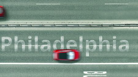 Aerial down view of the motorway with cars revealing Philadelphia caption. Car travel to the United States 3D rendering