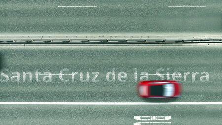 Top down view of the highway with revealing Santa cruz de la sierra text. Driving in Bolivia 3D rendering