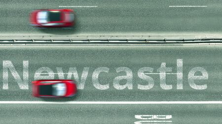Aerial top-down view of the road. Cars reveal Newcastle text. Travel to the United Kingdom 3D rendering