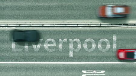 Aerial down view of the motorway with cars revealing Liverpool caption. Car travel to the United Kingdom 3D rendering