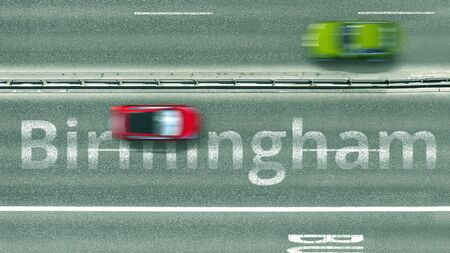 Overhead view of the busy car road with Birmingham text. Travel to the United Kingdom 3D rendering