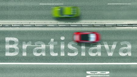 Aerial down view of the motorway with cars and Bratislava caption. Car travel to Slovakia 3D rendering