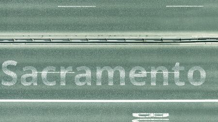 Aerial top down view of the road with Sacramento caption. Car travel in the United States 3D rendering