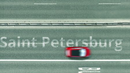 Aerial top down view of the road with Saint Petersburg caption. Car travel in Russia 3D rendering