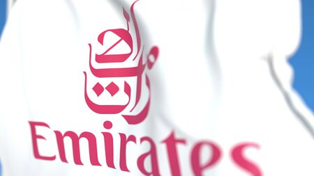 Waving flag with Emirates Airline logo, close-up. Editorial 3D rendering