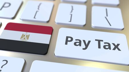 PAY TAX text and flag of Egypt on the buttons on the computer keyboard. Taxation related conceptual 3D rendering