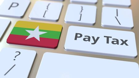 PAY TAX text and flag of Myanmar on the buttons on the computer keyboard. Taxation related conceptual 3D rendering Imagens