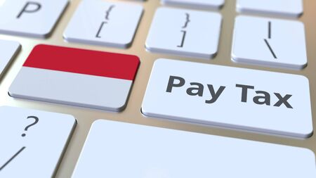 PAY TAX text and flag of Indonesia on the buttons on the computer keyboard. Taxation related conceptual 3D rendering