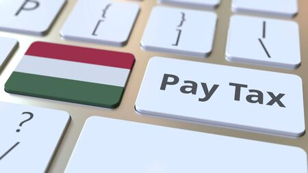 PAY TAX text and flag of Hungary on the buttons on the computer keyboard. Taxation related conceptual 3D rendering