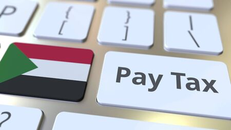 PAY TAX text and flag of Sudan on the computer keyboard. Taxation related conceptual 3D rendering Imagens