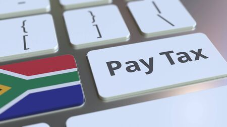 PAY TAX text and flag of South Africa on the computer keyboard. Taxation related conceptual 3D rendering Imagens