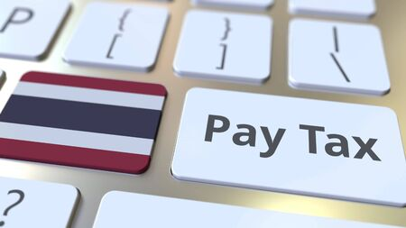 PAY TAX text and flag of Thailand on the computer keyboard. Taxation related conceptual 3D rendering Imagens