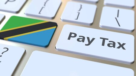 PAY TAX text and flag of Tanzania on the buttons on the computer keyboard. Taxation related conceptual 3D rendering