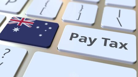 PAY TAX text and flag of Australia on the buttons on the computer keyboard. Taxation related conceptual 3D rendering Standard-Bild - 129268269