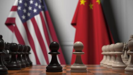 Flags of the USA and China behind chess board. The first pawn moves in the beginning of the game. Political rivalry conceptual 3D rendering