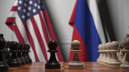 Flags of the USA and Russia behind chess board. The first pawn moves in the beginning of the game. Political rivalry conceptual 3D rendering