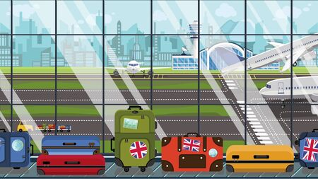 Suitcases with UK flag stickers on baggage carousel in airport. British tourism related illustration