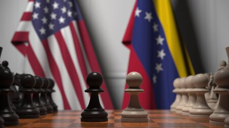Flags of United States and Venezuela behind chess board. The first pawn moves in the beginning of the game. Political rivalry conceptual 3D rendering Stockfoto