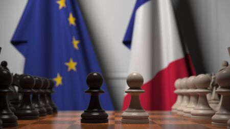 Flags of the EU and France behind chess board. The first pawn moves in the beginning of the game. Political rivalry conceptual 3D rendering Stockfoto