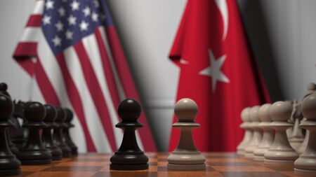 Flags of United States and Turkey behind chess board. The first pawn moves in the beginning of the game. Political rivalry conceptual 3D rendering