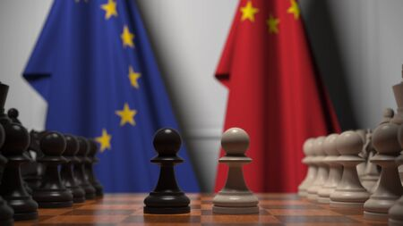 Flags of the EU and China behind chess board. The first pawn moves in the beginning of the game. Political rivalry conceptual 3D rendering