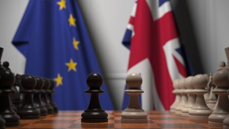 Flags of the EU and the UK behind chess board. The first pawn moves in the beginning of the game. Brexit related conceptual 3D rendering