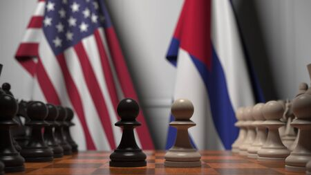 Flags of United States and Cuba behind chess board. The first pawn moves in the beginning of the game. Political rivalry conceptual 3D rendering