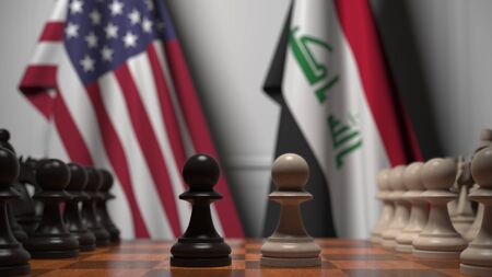 Flags of United States and Iraq behind chess board. The first pawn moves in the beginning of the game. Political rivalry conceptual 3D rendering