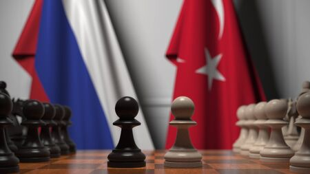 Flags of Russia and Turkey behind chess board. The first pawn moves in the beginning of the game. Political rivalry conceptual 3D rendering