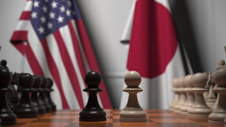 Flags of United States and Japan behind chess board. The first pawn moves in the beginning of the game. Political rivalry conceptual 3D rendering
