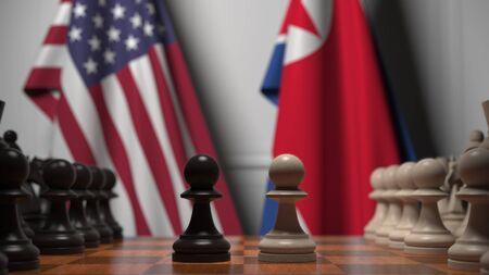 Drapeaux des États-Unis et de la Corée du Nord derrière l'échiquier. Le premier pion se déplace au début de la partie. Rendu 3D conceptuel de rivalité politique Banque d'images