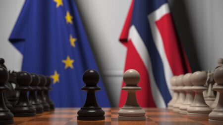 Flags of the EU and Norway behind chess board. The first pawn moves in the beginning of the game. Political rivalry conceptual 3D rendering