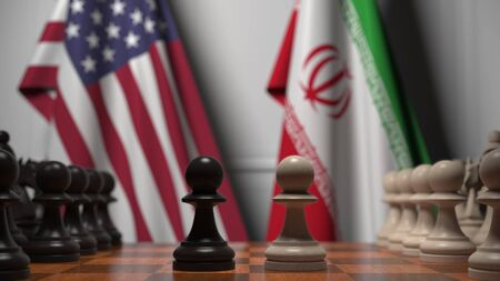 Flags of United States and Iran behind chess board. The first pawn moves in the beginning of the game. Political rivalry conceptual 3D rendering Stockfoto