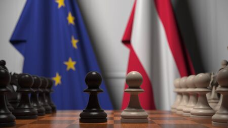 Flags of the EU and Austria behind chess board. The first pawn moves in the beginning of the game. Political rivalry conceptual 3D rendering