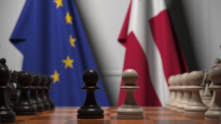 Flags of the EU and Denmark behind chess board. The first pawn moves in the beginning of the game. Political rivalry conceptual 3D rendering