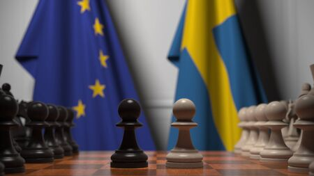 Flags of the EU and Sweden behind chess board. The first pawn moves in the beginning of the game. Political rivalry conceptual 3D rendering 写真素材