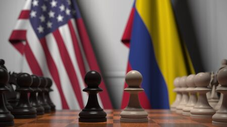 Flags of United States and Colombia behind chess board. The first pawn moves in the beginning of the game. Political rivalry conceptual 3D rendering