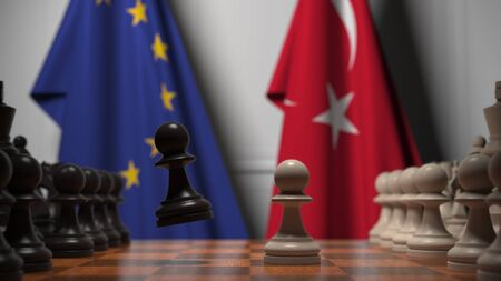 Flags of the EU and Turkey behind chess board. The first pawn moves in the beginning of the game. Political rivalry conceptual 3D rendering