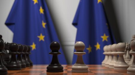 Flags of the European Union behind chess board. The first pawn moves in the beginning of the game. Political rivalry conceptual 3D rendering