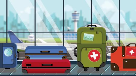 Suitcases with Swiss flag stickers on baggage carousel in airport, close-up. Tourism in Switzerland related illustration Stock Photo