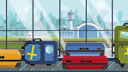 Suitcases with Sweden flag stickers on baggage carousel in airport, close-up. Swedish tourism related illustration