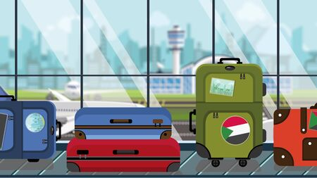 Suitcases with Sudanian flag stickers on baggage carousel in airport, close-up. Travel to Sudan related illustration Imagens
